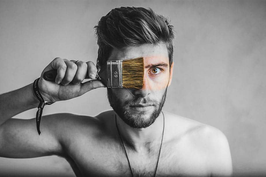 screenshot of a man with a paintbrush representing unlimited colours for themes